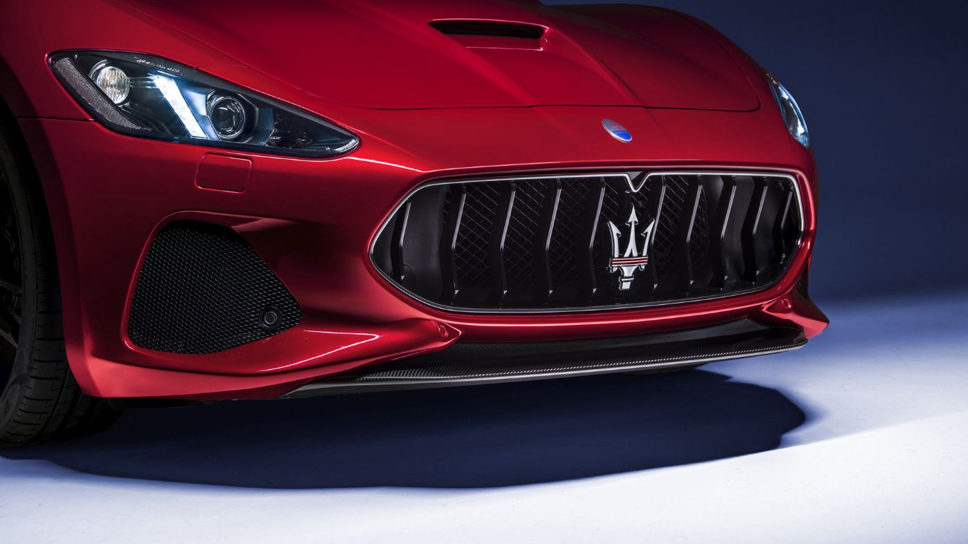 Maserati GranTurismo front view,  detail of headlights and bumper with logo