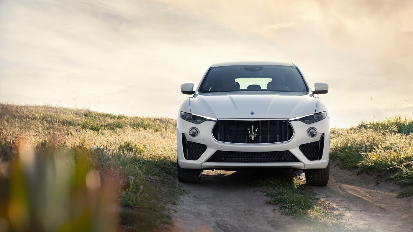 White Maserati Levante on the road - Side view